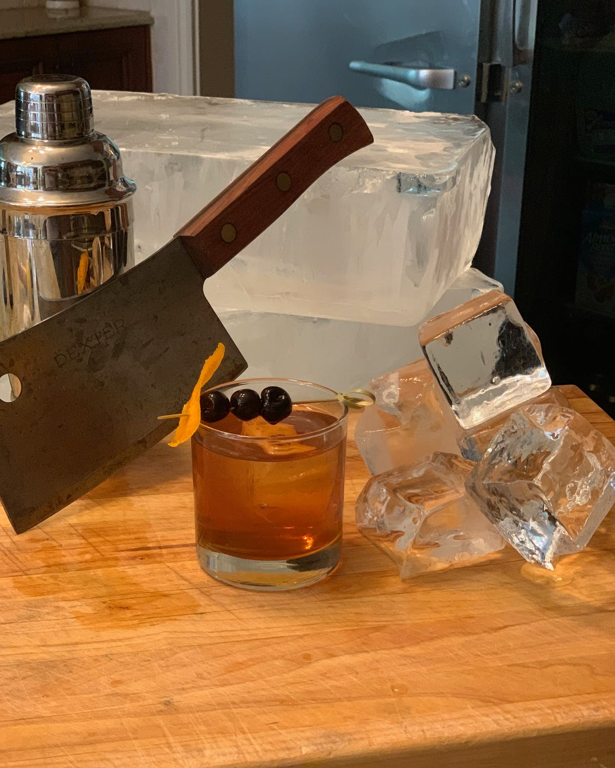 a butcher's knife with a drink