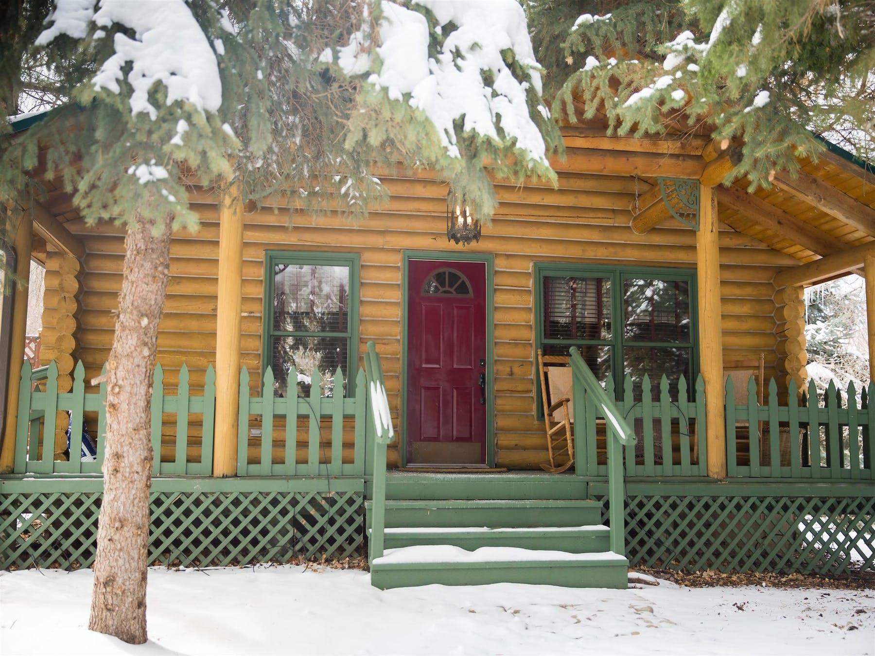 a snowy cabin entrance