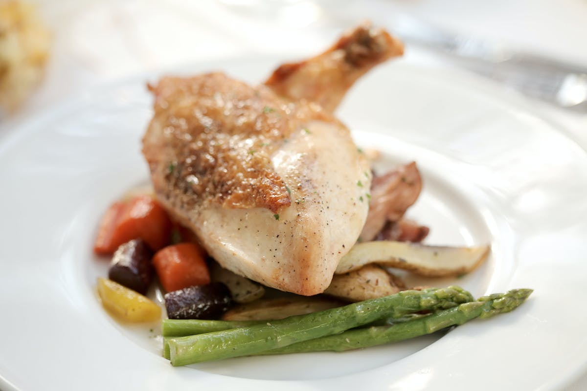 a chicken plate with esparagus