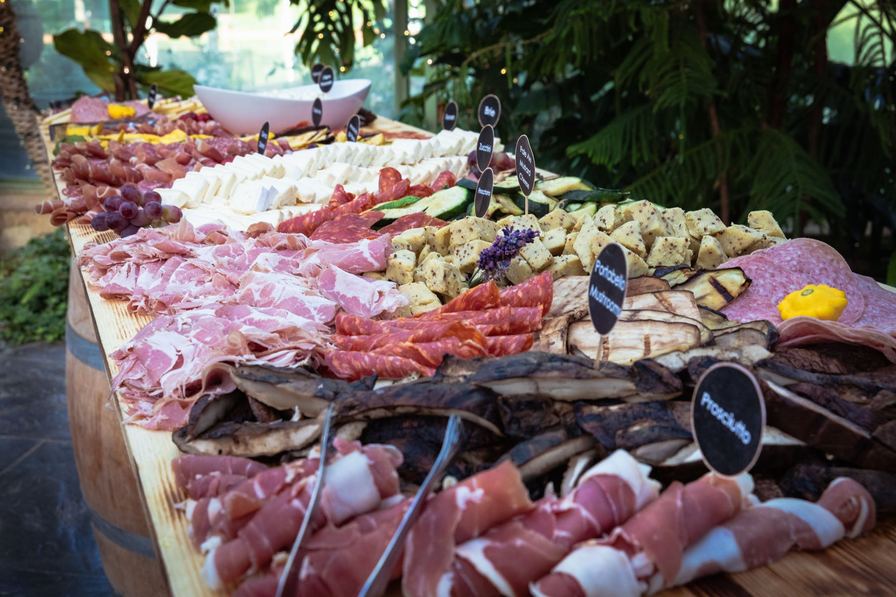 raw meat, jam and differnt types of food on a buffet table