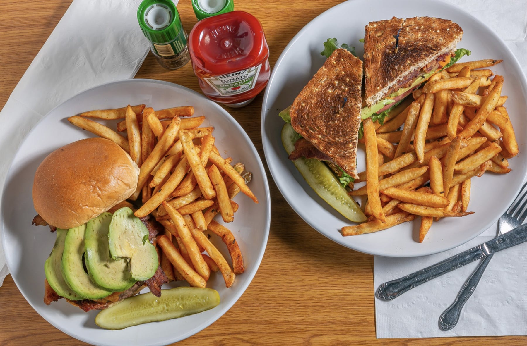 a plate of food with a sandwich and fries on a table