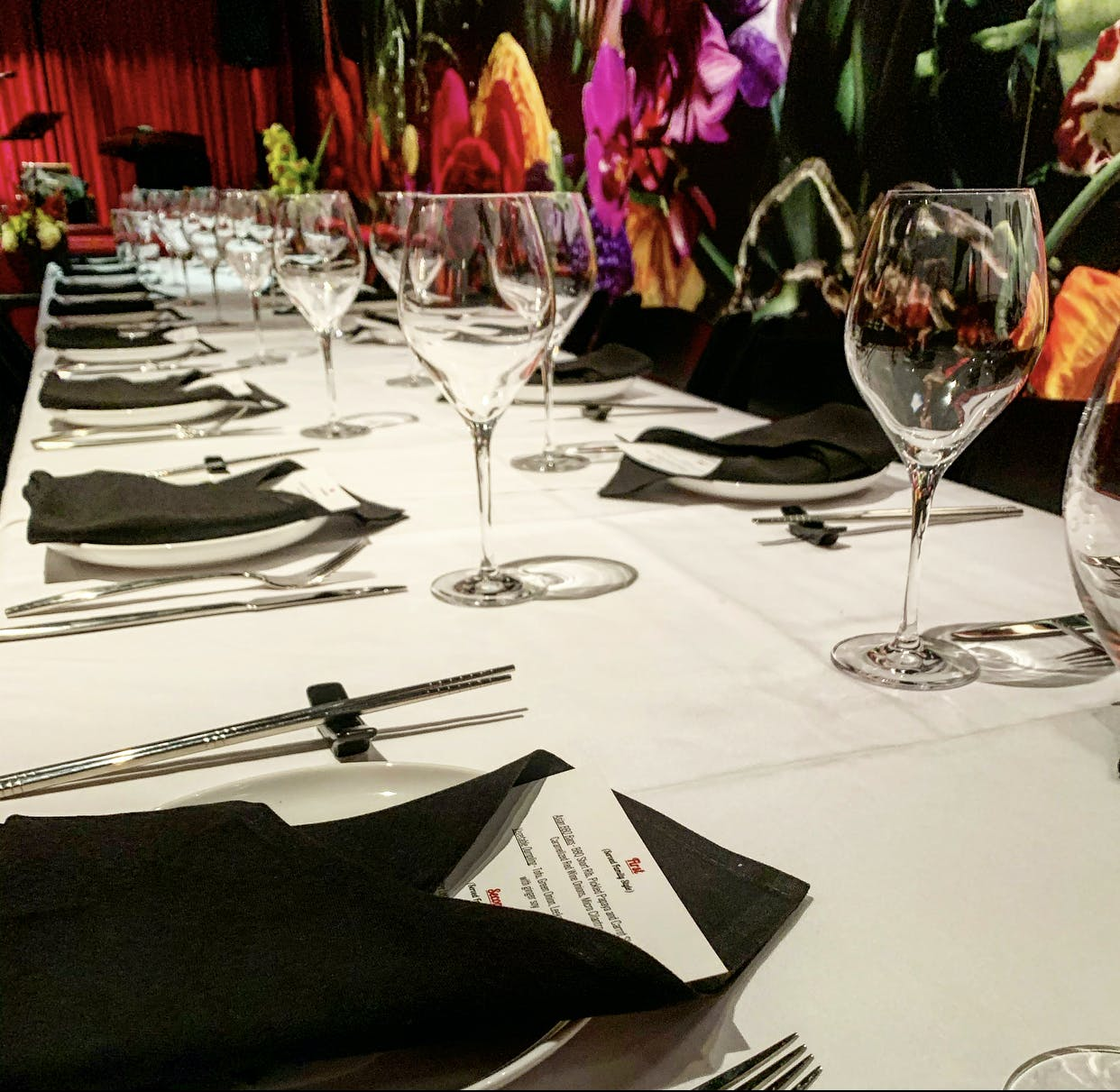 a large table filled with plates and wine cups