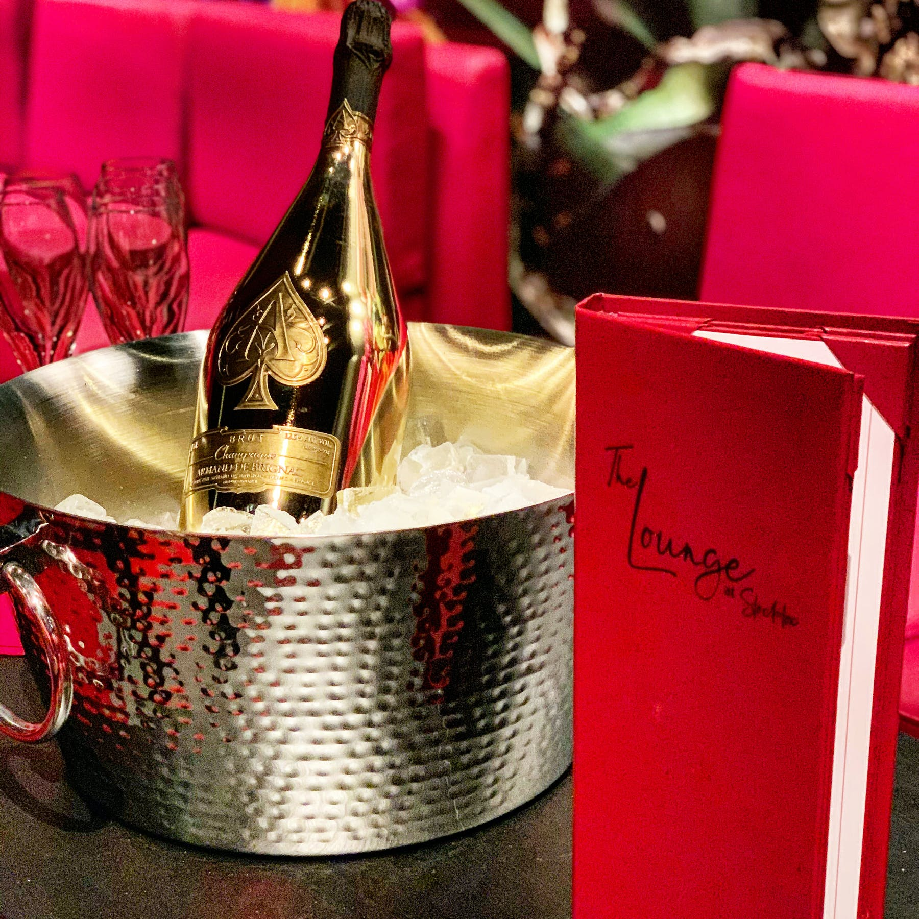 a champagne bottle on a bowl filled with ice
