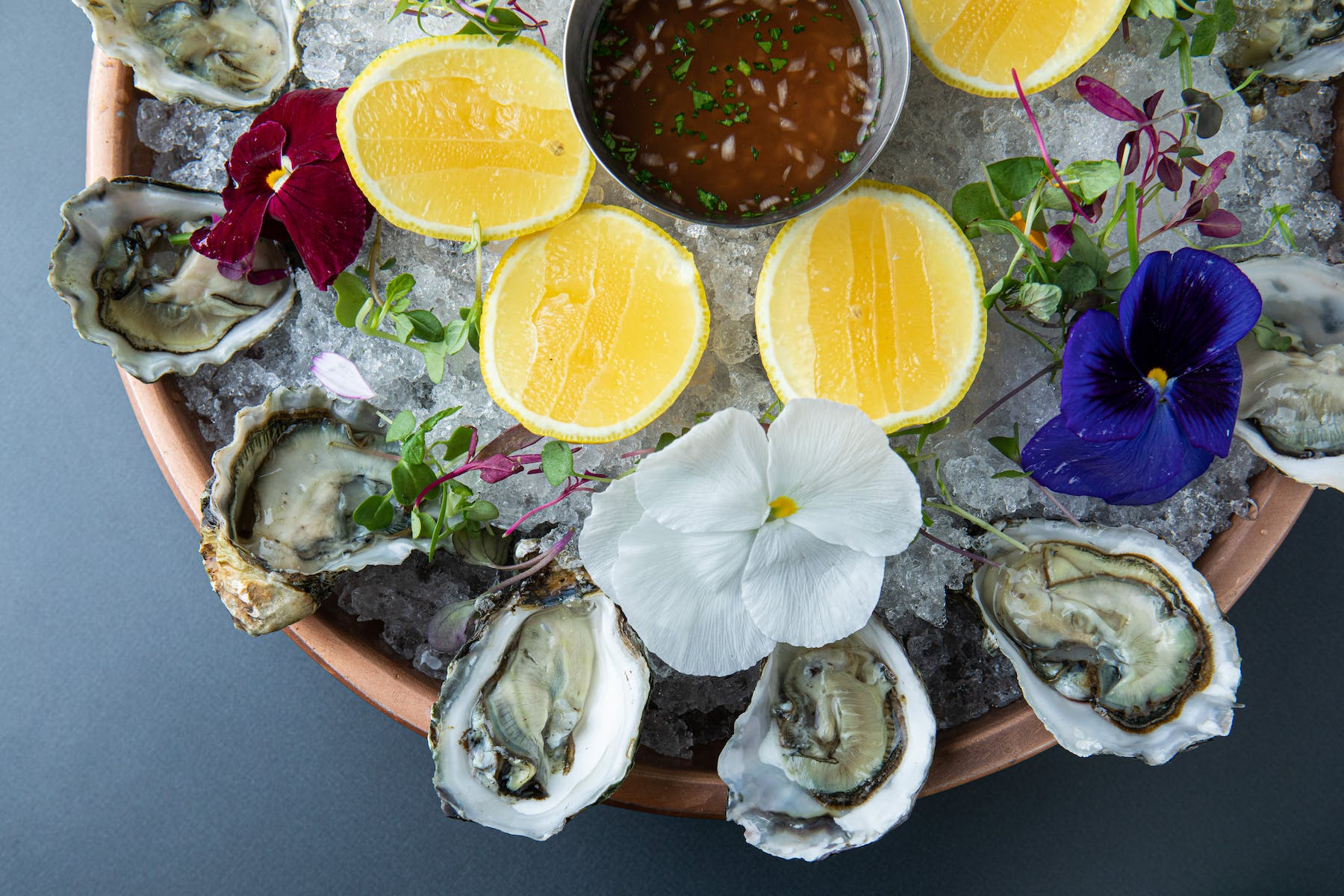 a plate filled with ice and oysters