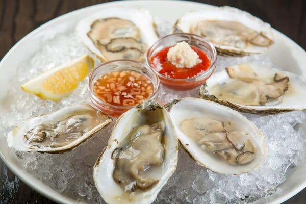 a plate filled with oysters