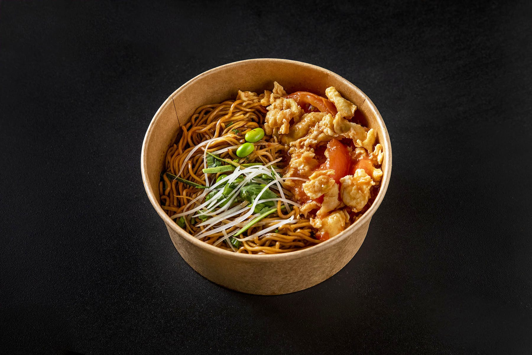 bowl of noodles topped with veggies