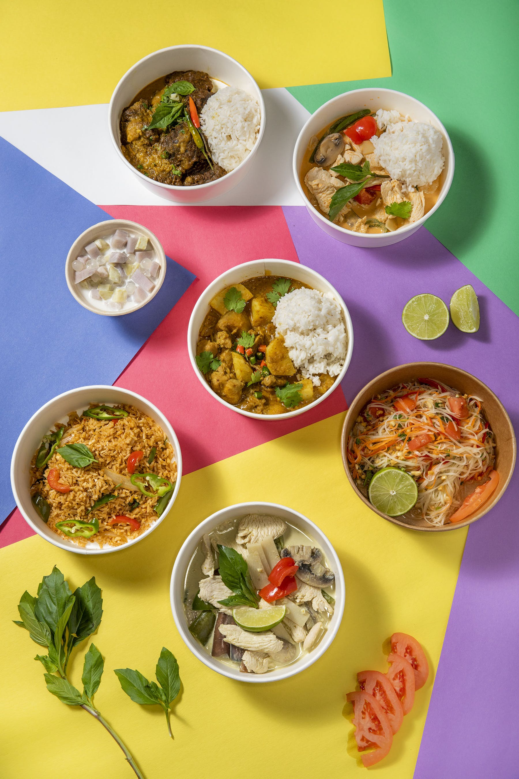 an overview of multiple bowls of food