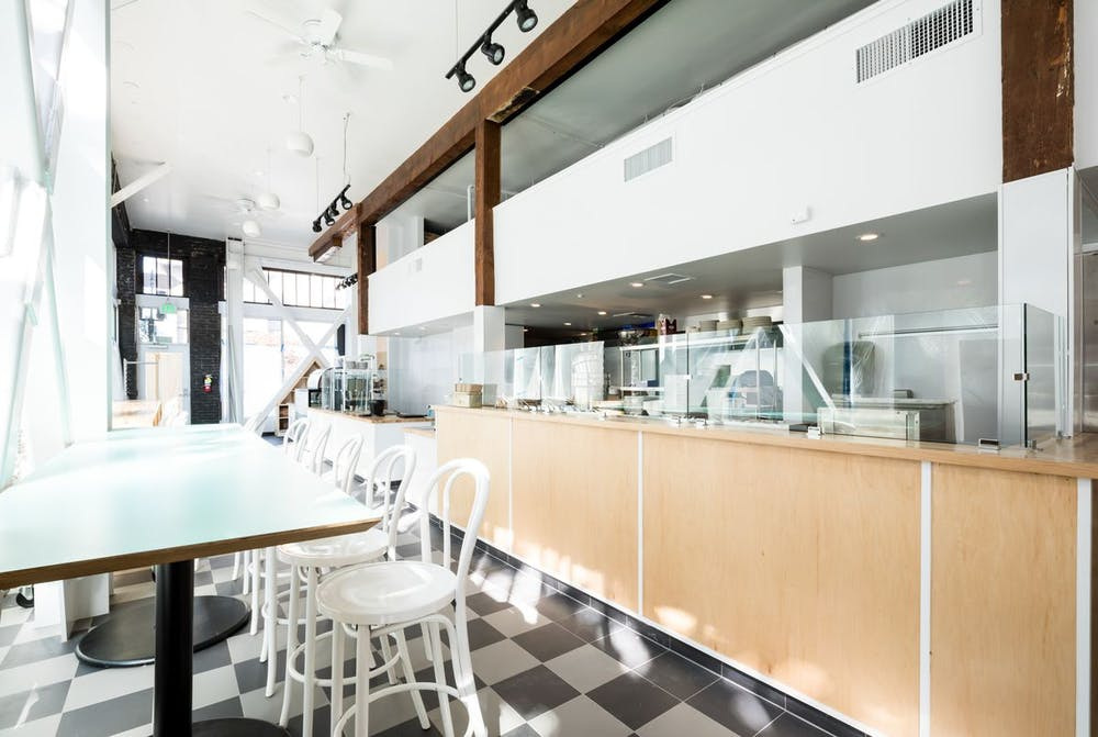 a kitchen with a table in a restaurant