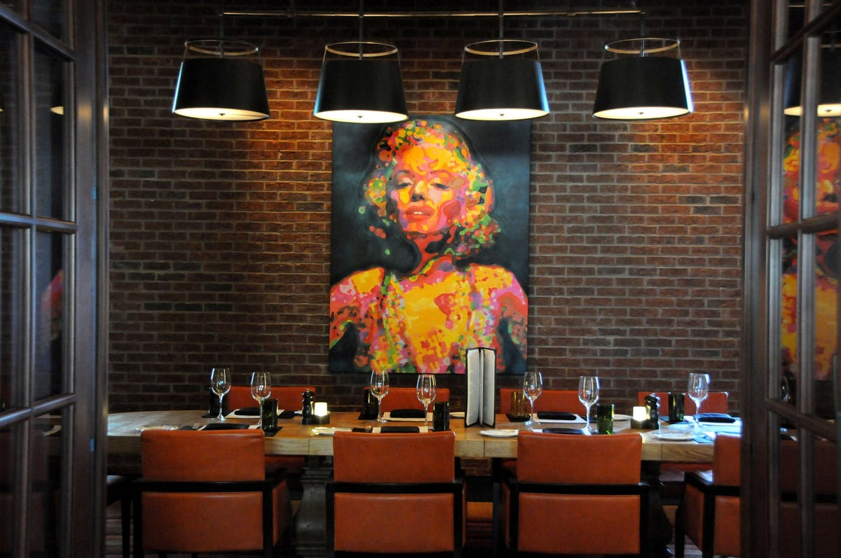 restaurant wall with a painting