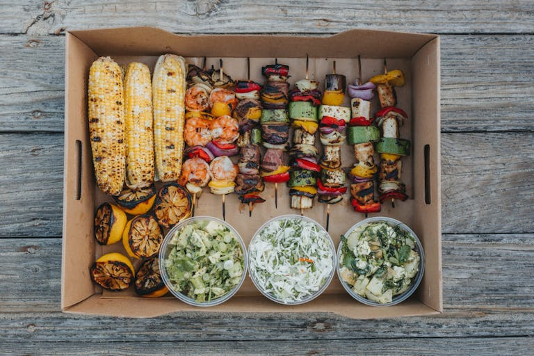 a bunch of food sitting on top of a wooden counter