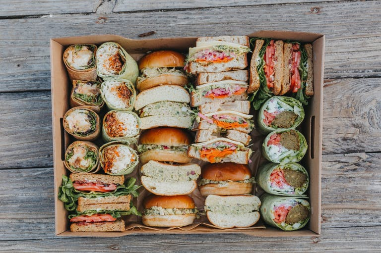 a bunch of food sitting on a grill