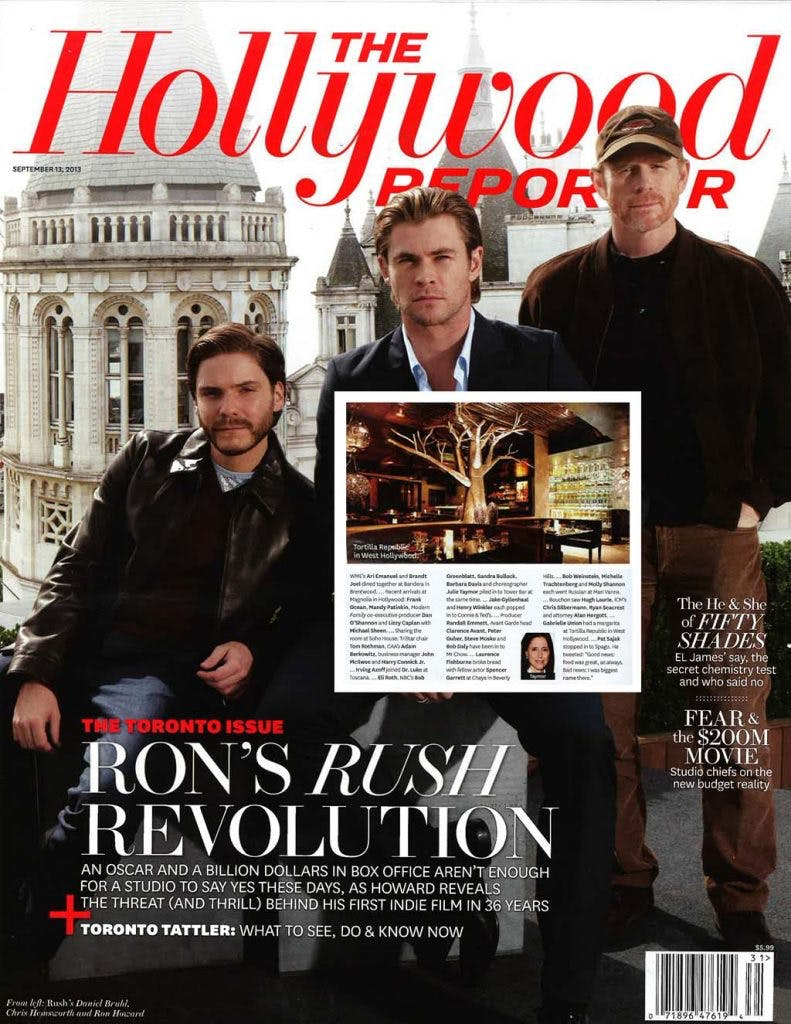 Daniel Bruhl, Chris Hemsworth on a newspaper