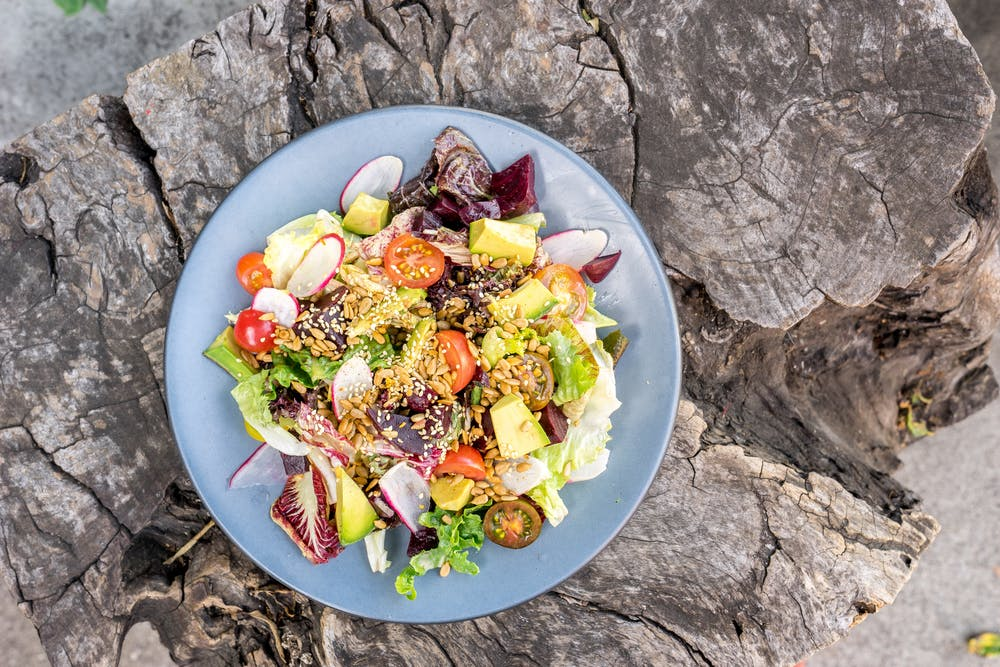 a bowl of food on a rock