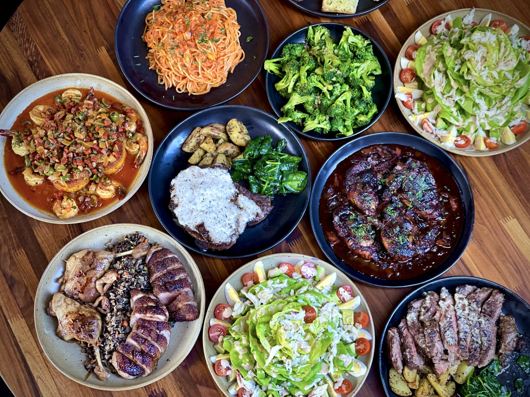 many different types of food on a wooden table