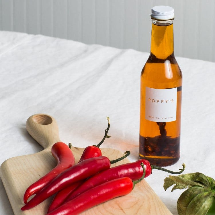 a bottle of chili oil on a table
