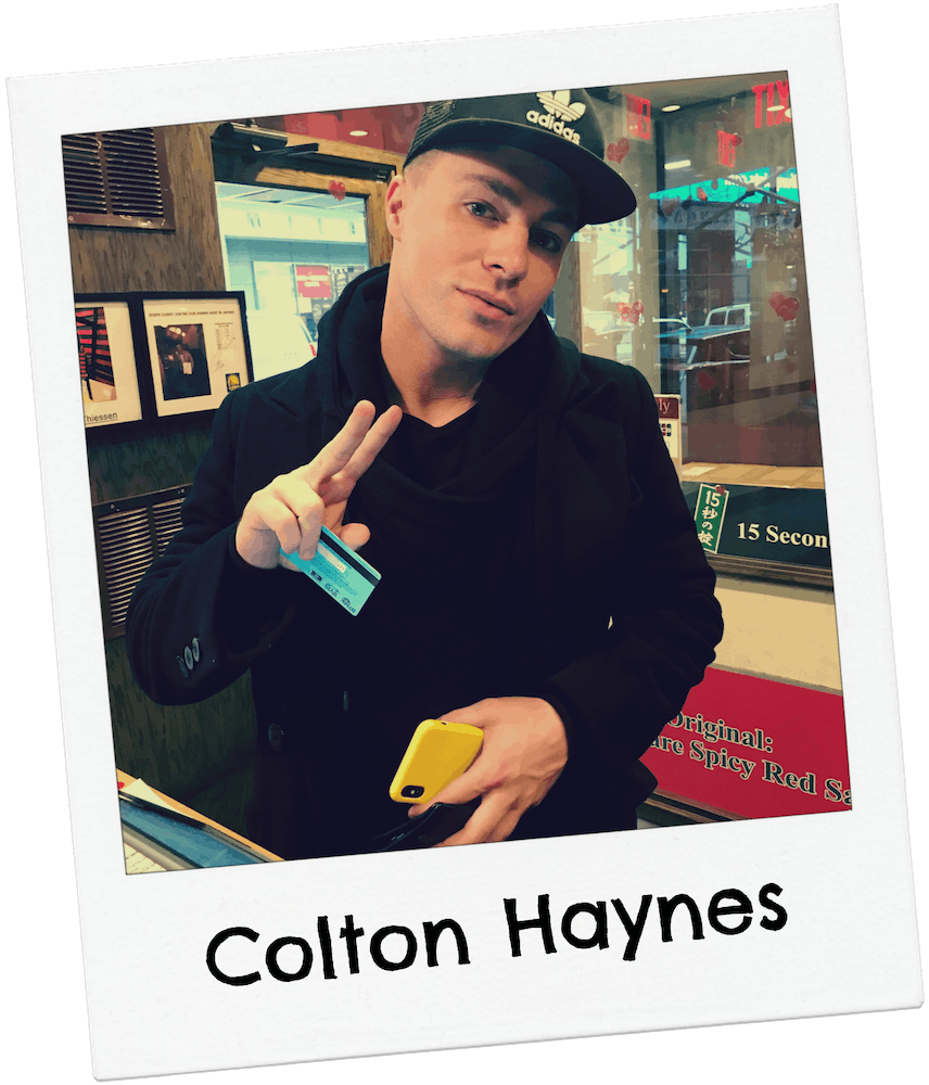 Colton Haynes giving peace sign