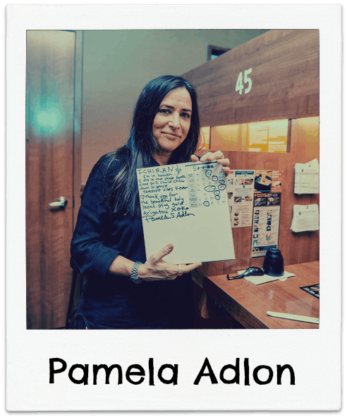 Pamela Adlon holding a sign