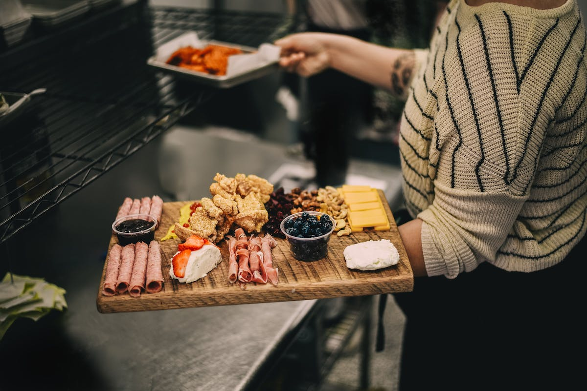 a cheese and ham wooden board