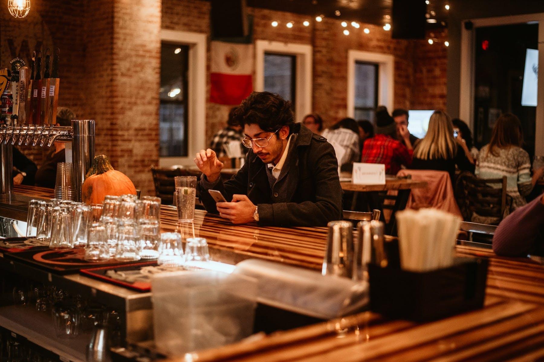 a man sitting at the bar