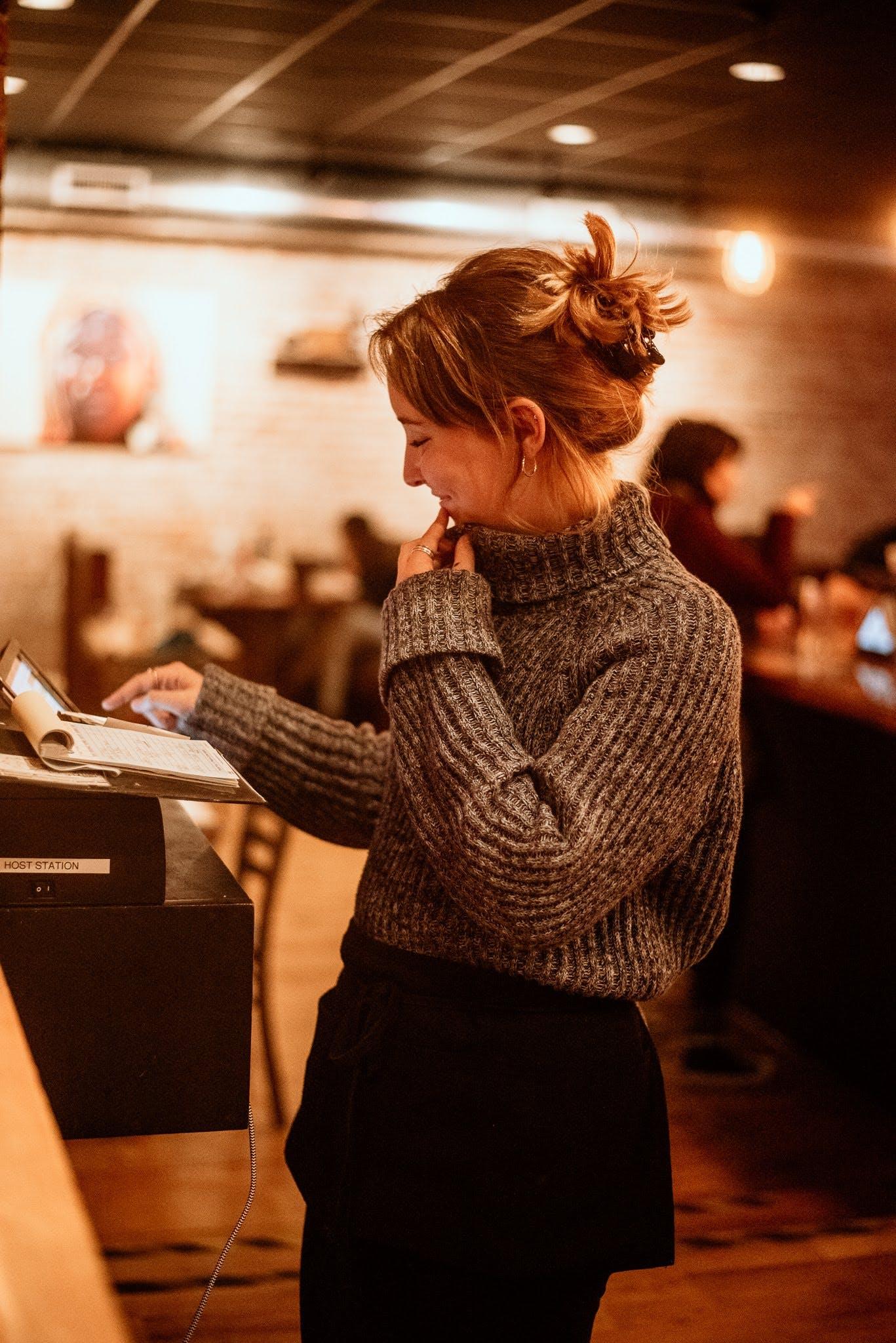 a waitress standing