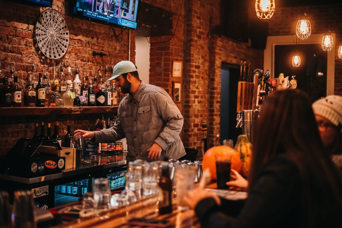 a man standing in the bar