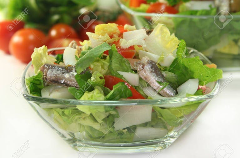 a close up of a bowl of salad
