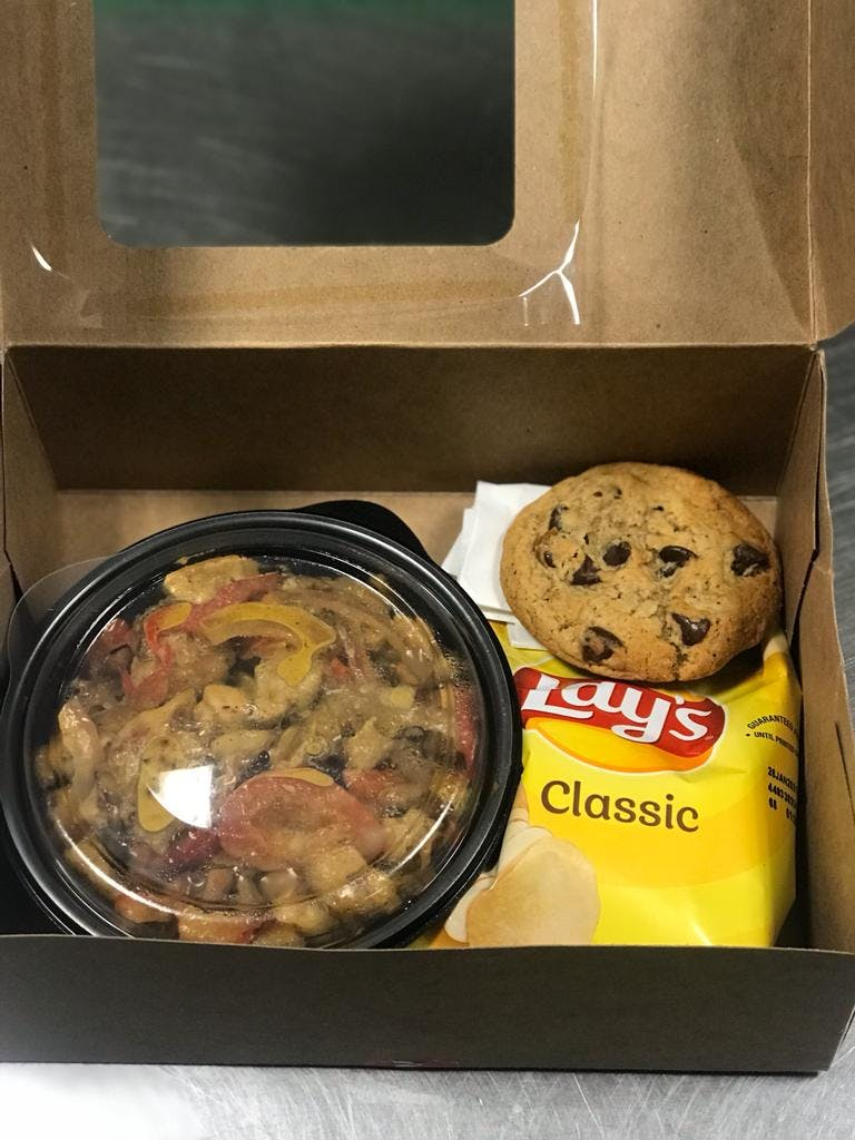 a tray of food on a stove top oven sitting inside of a box