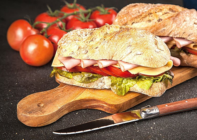 a cut in half sandwich sitting on top of a table