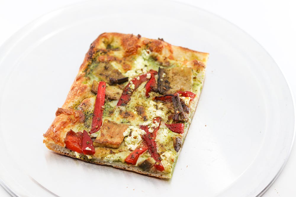 a slice of pizza on a plate
