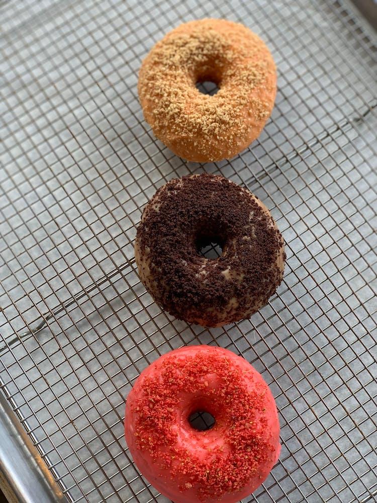 a doughnut sitting next to a donut