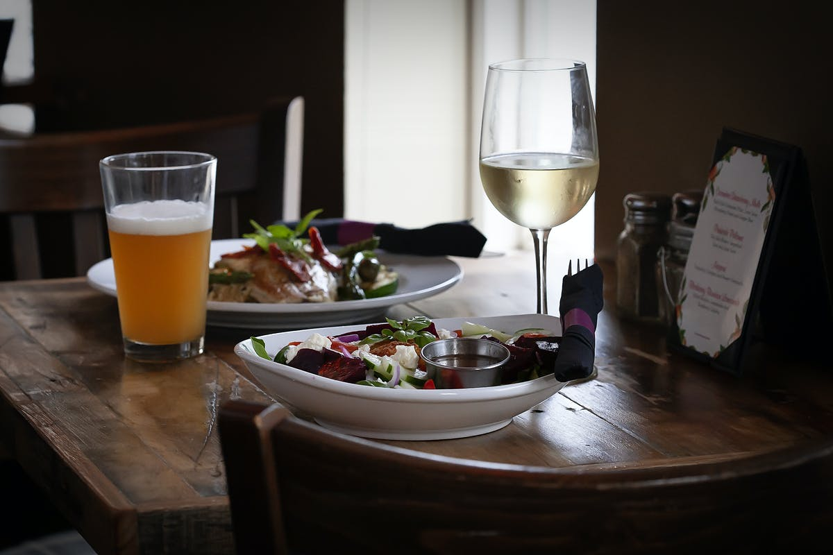 a plate of food and a glass on a table