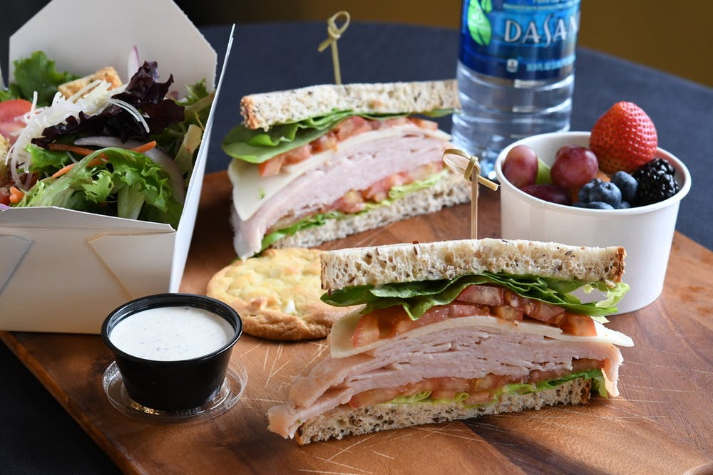 a sandwich sitting on top of a wooden table