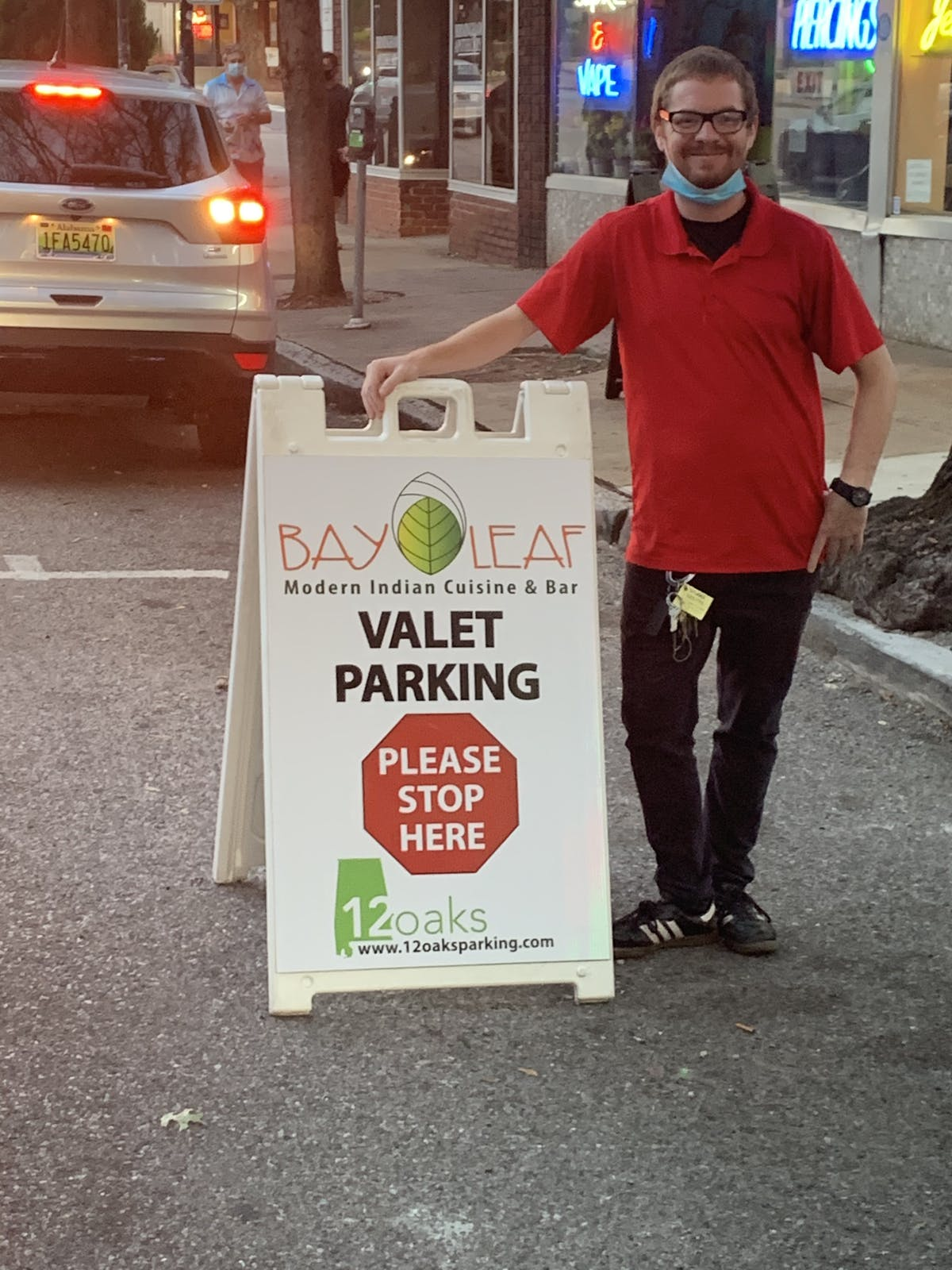 a man standing in front of a sign