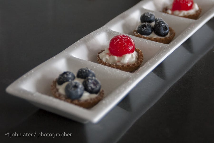 a plate with bite size desserts
