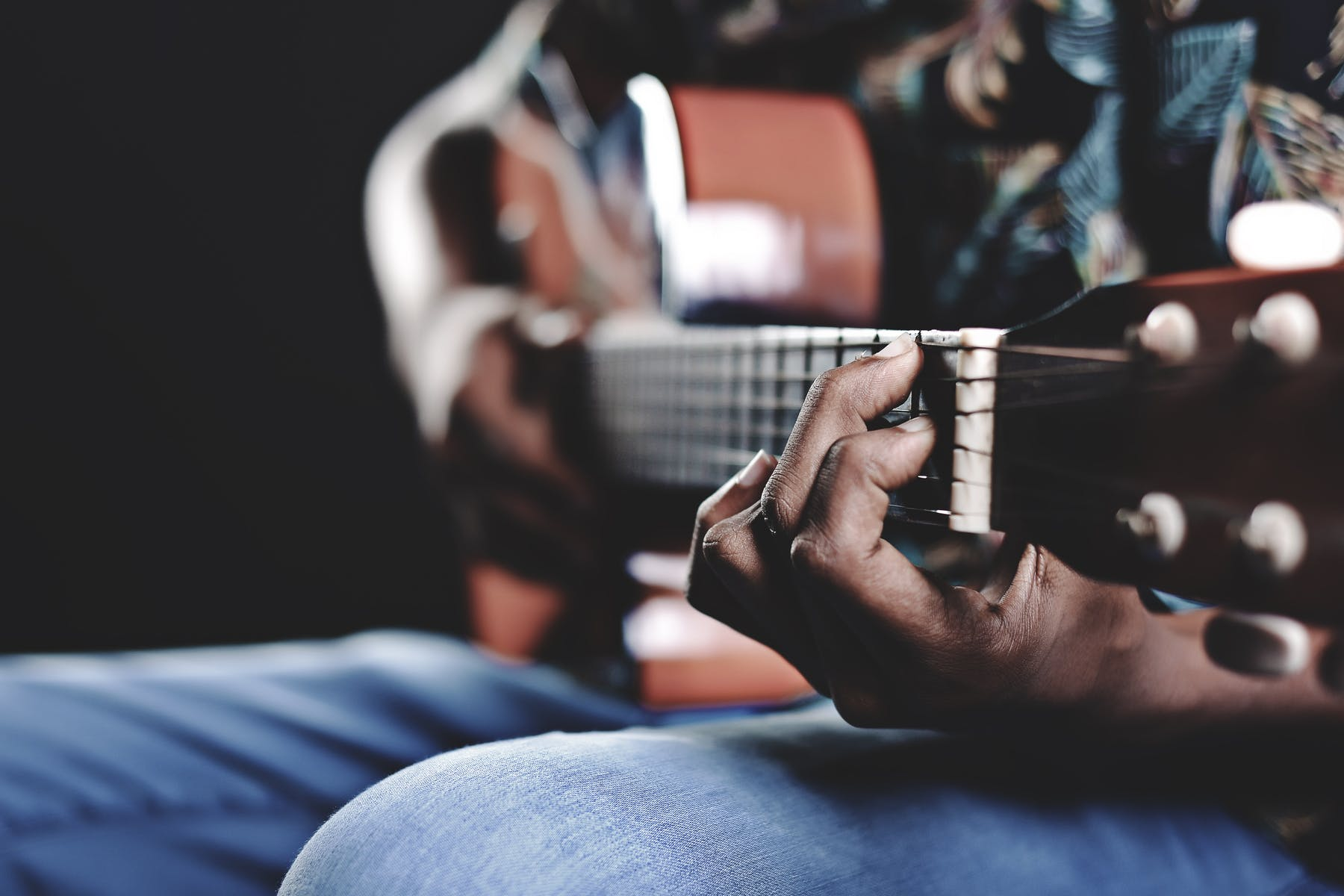 a close up of a person holding a guitar