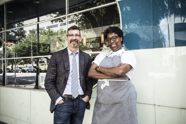 Chef Mashama Bailey and Johno Morisano standing in front of a building