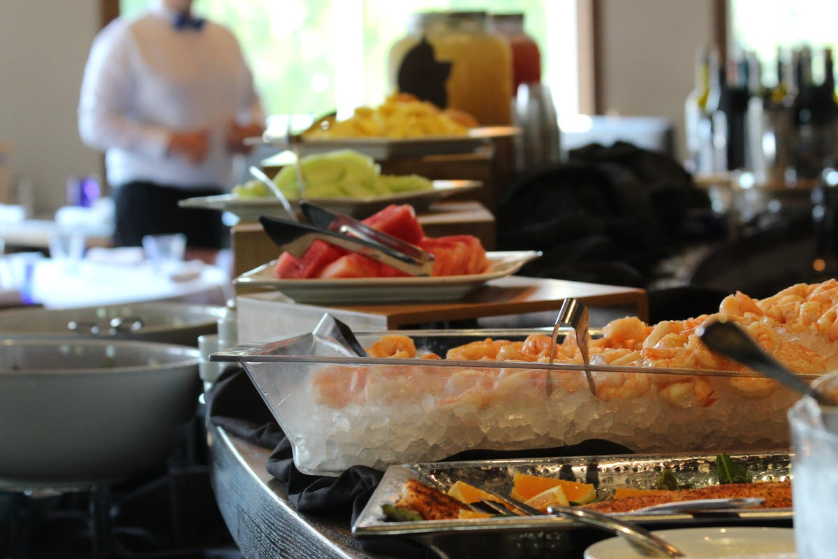 an array of food trays on a table filled with different types of food