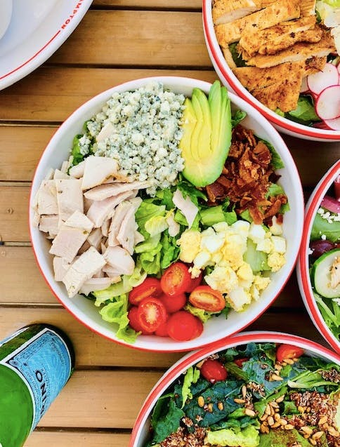 a bowl filled with different types of food on a plate
