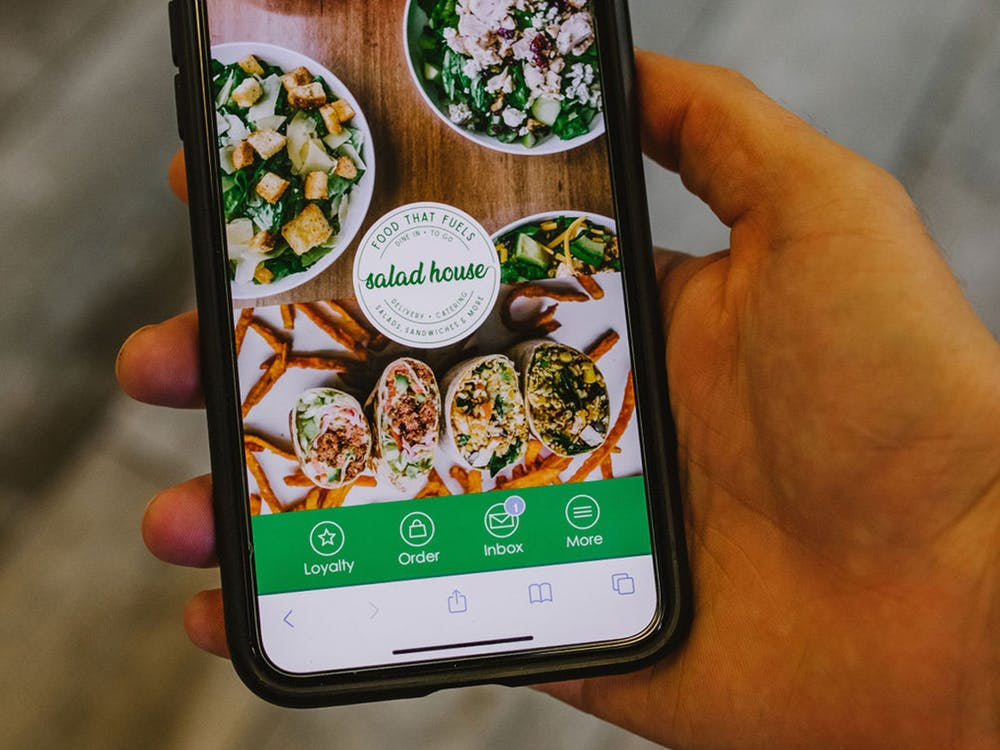Using The Salad House mobile app for food delivery.