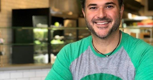 a man wearing a green shirt