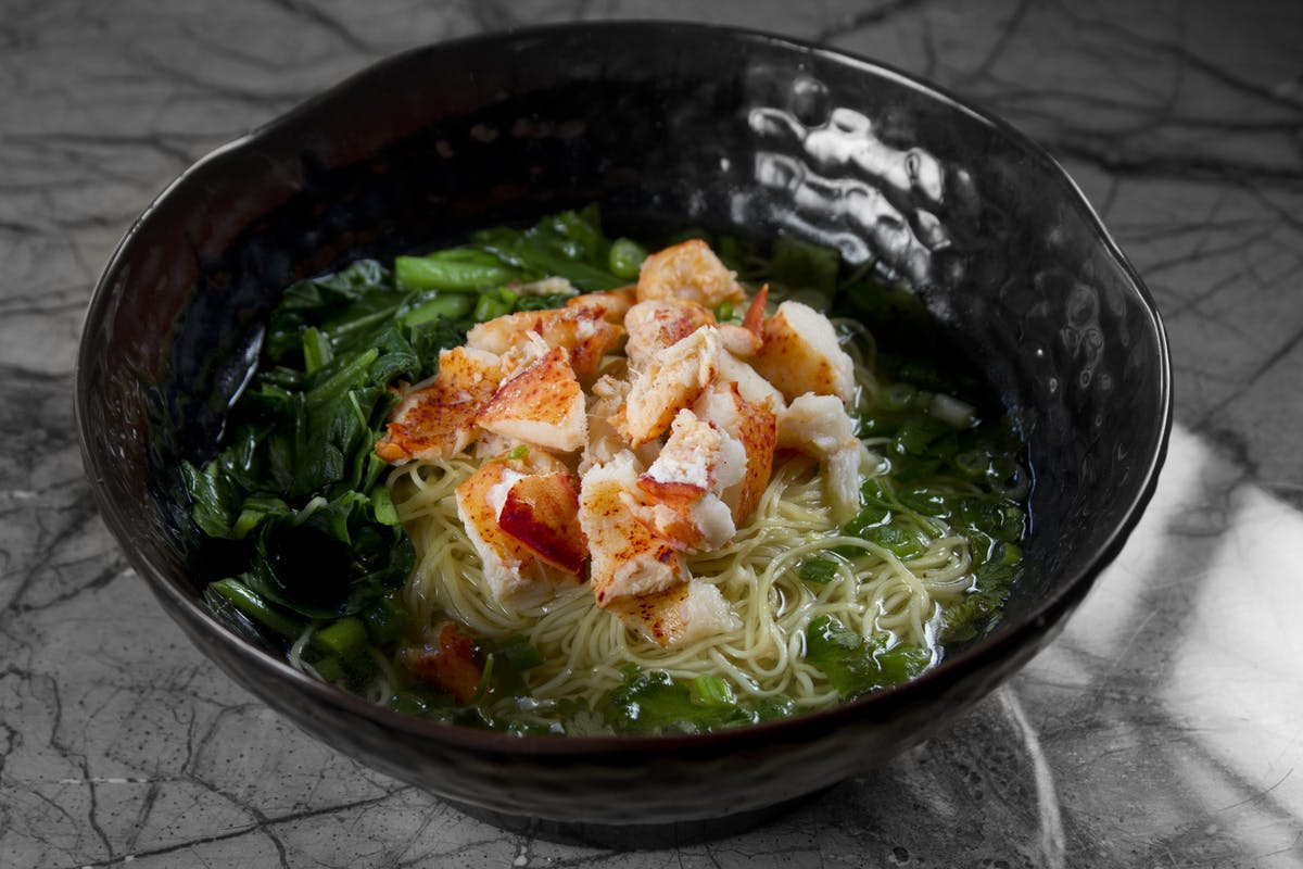 a bowl filled with shrimp and ramen