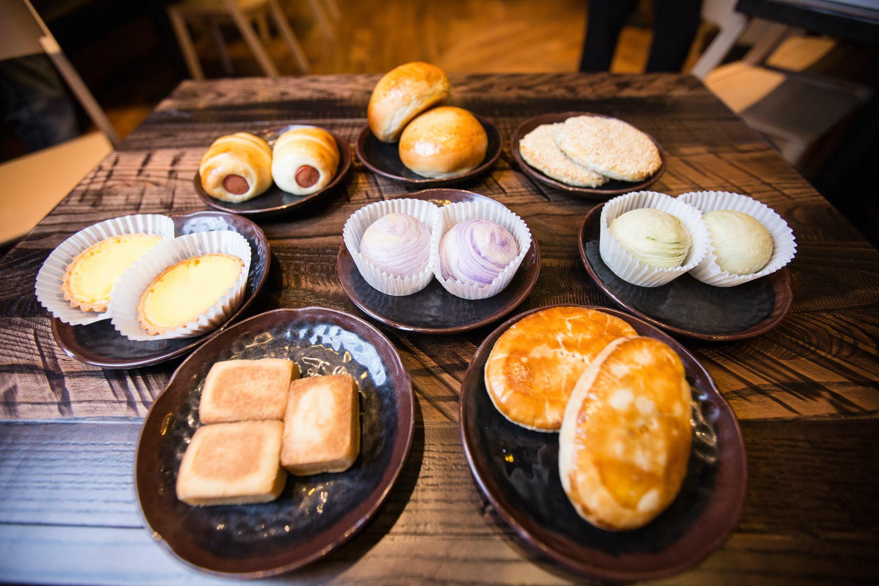 an array of plates topped with different types of food