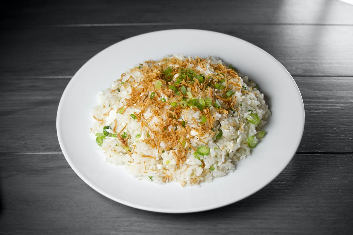 a bowl filled with rice and topped with gravy