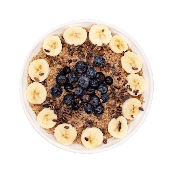 a close up of a bowl with banana and blueberry