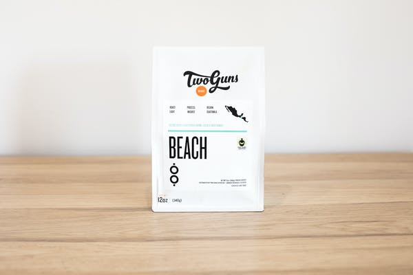 PHoto of Beach (Single Origin, Fair Trade Certified)  Light and balanced, this single-origin coffee hails from the Rio Azul Cooperative in Guatemala and is Fair Trade Certified. Let each sip transport you to warm sand, an ocean breeze and a smooth taste that's pure heaven.