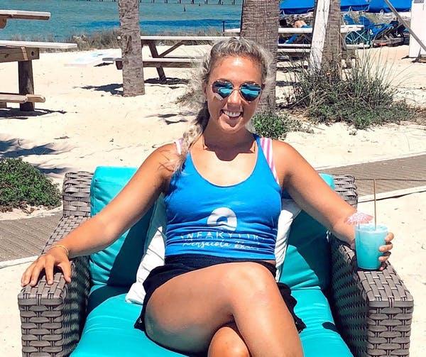 a woman sitting at a beach