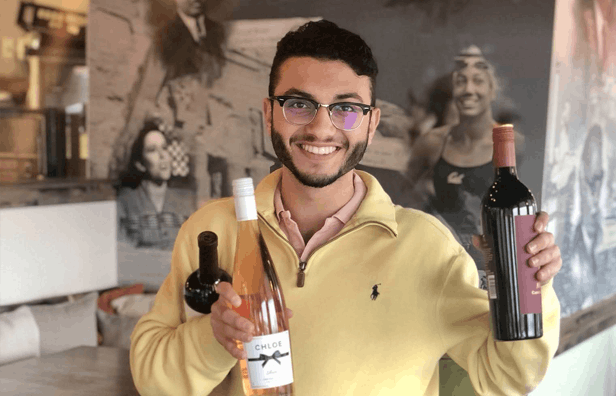 a person holding a bottle of wine