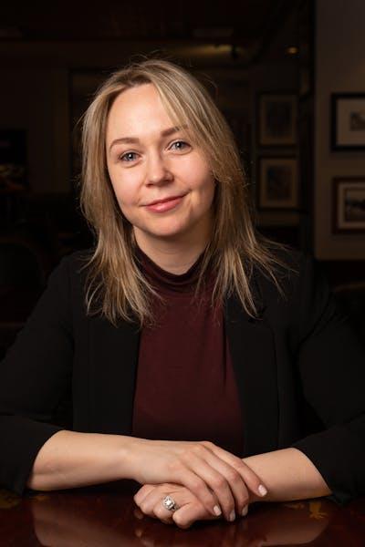 a woman looking at the camera