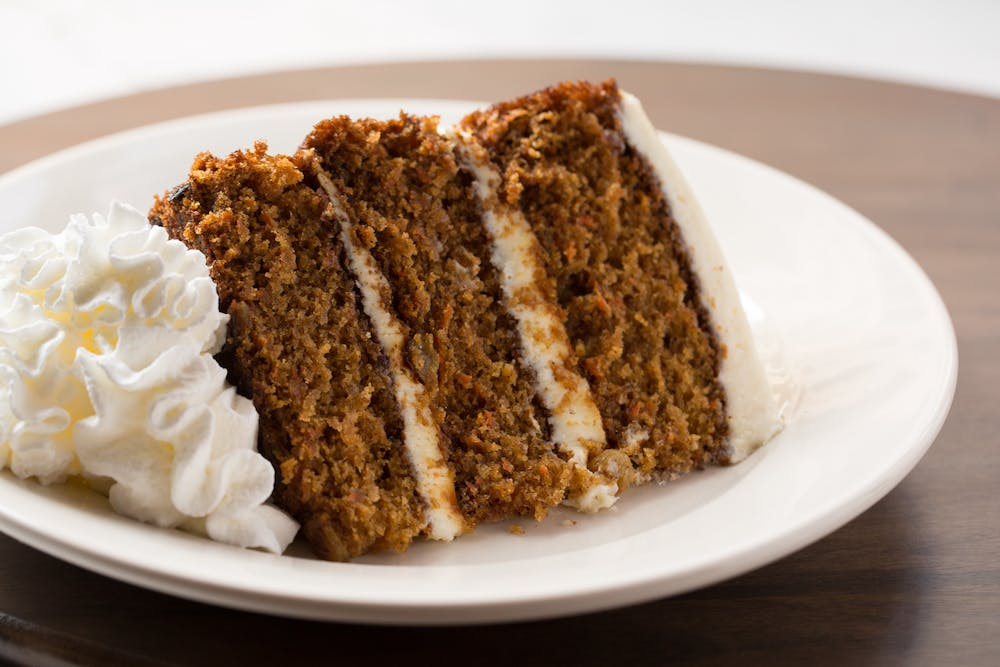 a piece of cake sitting on top of a white plate
