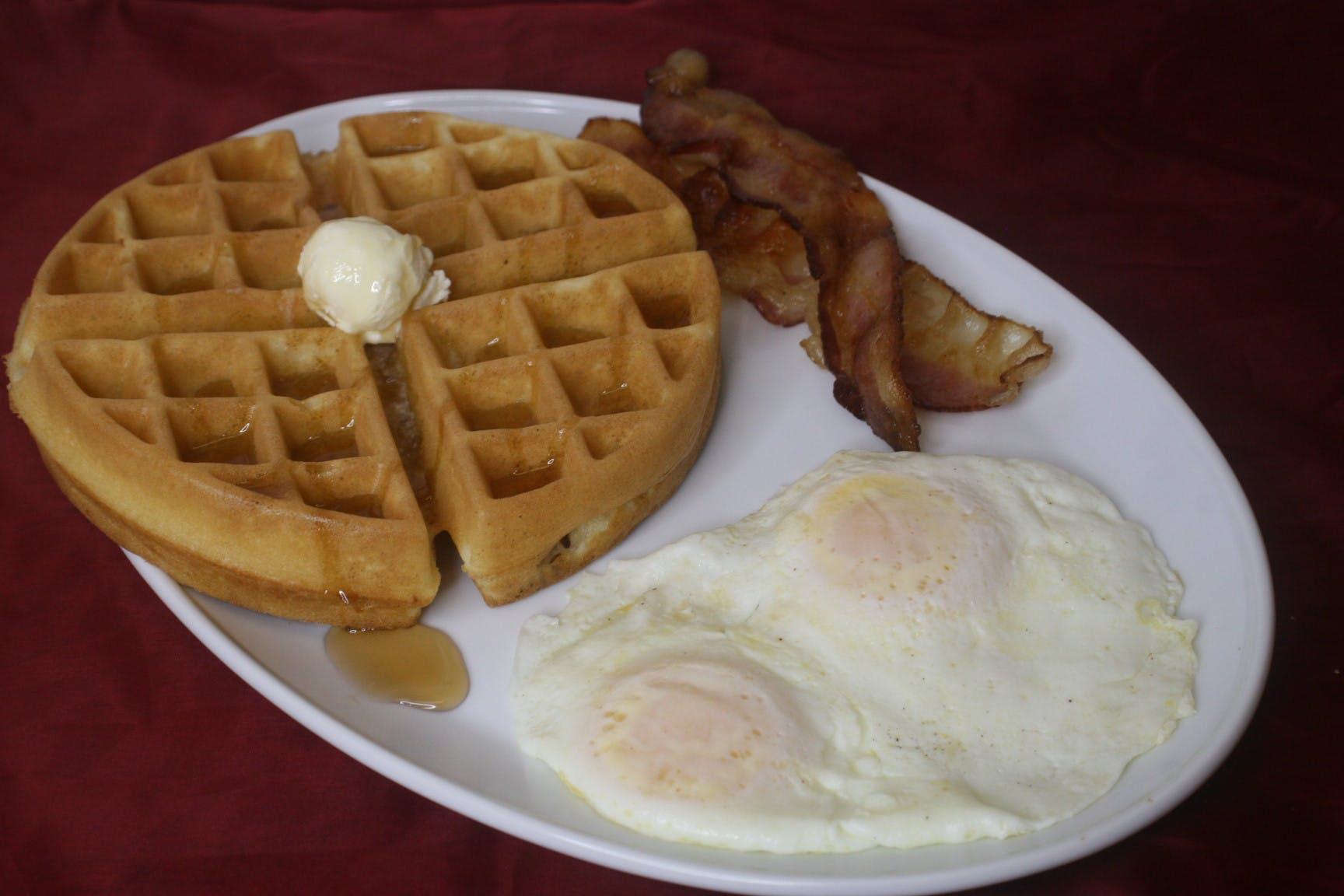 waffles with bacon and two eggs